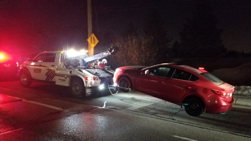 A tow truck prepares to take a vehicle away. (@WRPSToday / Twitter)