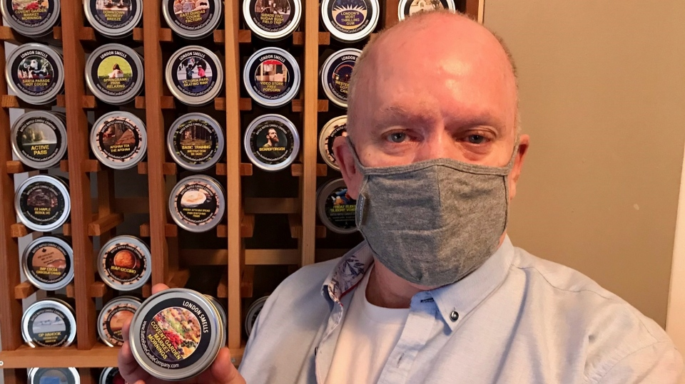 David Lewis, a London, Ont. veteran who started his own candle company stands with some of his products on Monday, March 1, 2021. (Sean Irvine / CTV News)