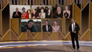 In this video grab issued Sunday, Feb. 28, 2021, by NBC, Joaquin Phoenix presents the award for best actress in a motion picture drama as the nominees appear on screen at the Golden Globe Awards. (NBC via AP)