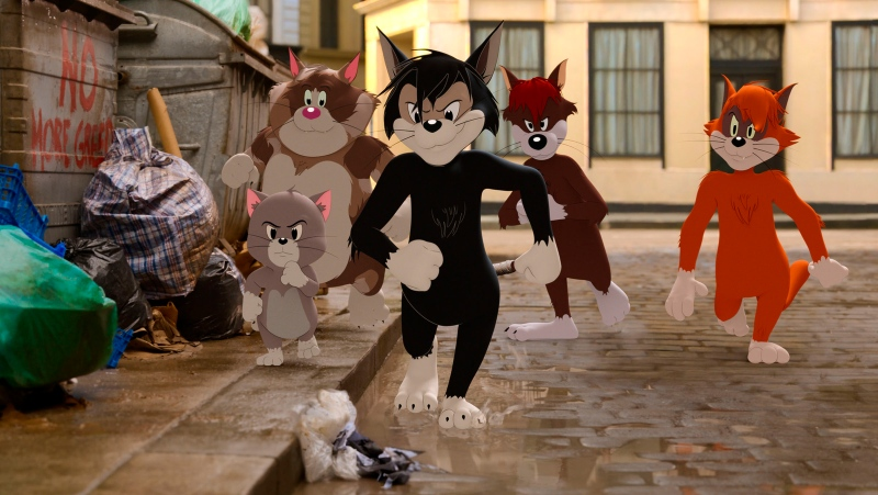 "This image shows Butch, leader of the alley cats, foreground center, voiced by Nicky Jam, in a scene from the animated/live-action film ""Tom & Jerry."" (Warner Bros. Pictures via AP)"