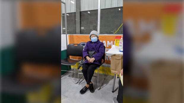 Betty Ing, the first adult 80 years of age and older who entered WFCU Centre to receive the Pfizer BioNTech vaccine in Windsor, Ont. on Monday, March 1, 2021. (courtesy Windsor Essex County Health Unit)