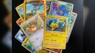 A pile of Pokémon cards that feature Pokémon such as Pikachu and Eevee. (Source: Devon McKendrick/CTV News)