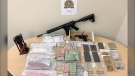 Some of the drugs, money and weapons seized by RCMP. (RCMP handout)