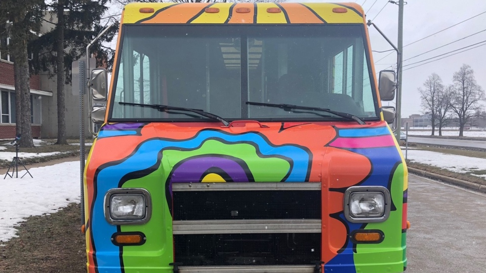 A Canada Post truck covered in the work of graphic artist Andrew Lewis is seen in London, Ont. on Monday, March 1, 2021. (Jordyn Read / CTV News)