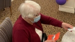 """The """"Crush COVID"""" celebration at Touchmark at Wedgewood in west Edmonton on Monday. (Dave Mitchell/CTV News Edmonton)"""