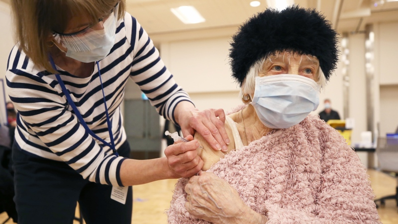 Nina Luhowy, 93, gets her shot at the COVID-19 vaccination super site in Winnipeg on Monday, March 1, 2021. THE CANADIAN PRESS/Kevin King - POOL