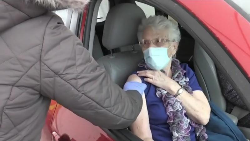 A woman receives the COVID-19 vaccine at a drive-thru immunization clinic in Simcoe Muskoka. (CTV News Barrie)