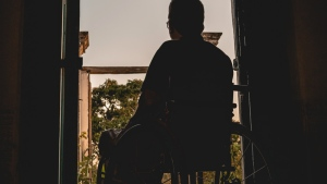File photo of someone in a wheelchair at a balcony. (Pexels/Alexandre Saraiva Carniato)
