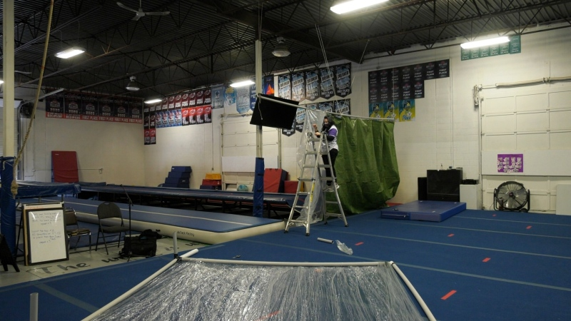 Rebels Cheerleading coach Lisa Dunbar installs barriers at their facility to allow more kids to practice at the same time. (Marc Smith/CTV News)