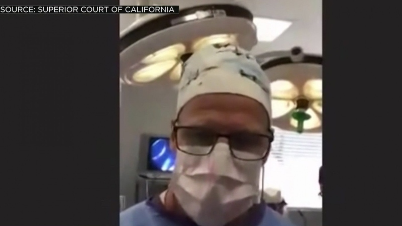 Dr. Scott Green, a plastic surgeon, showed up to his virtual Sacramento Superior Court hearing -- held over Zoom -- to contest a traffic violation, wearing scrubs, gloves, a mask and surgical cap. (Superior Court of CA /KOVR/CNN)