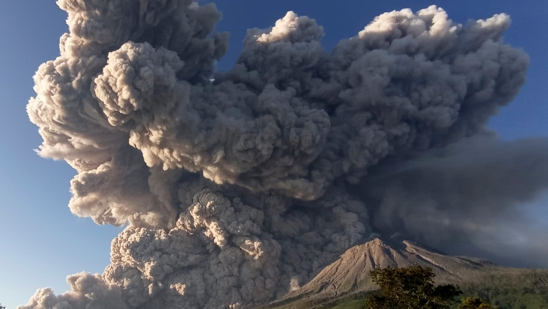 Mount Sinabung spews volcanic material during an eruption in Karo, North Sumatra, Indonesia, Tuesday, March 2, 2021. (AP Photo/Sastrawan Ginting)