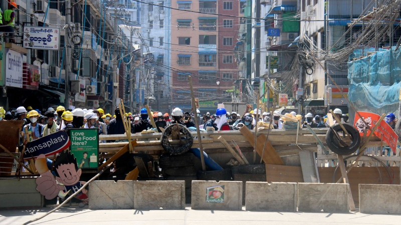 Protesters set up barricade during an anti-coup protest march in Yangon, Myanmar, Monday, March 1, 2021.  (AP Photo)