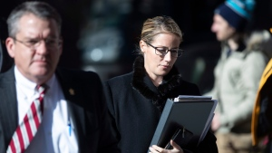 Attorneys for The Boy Scouts of America, Jessica Boelter, center, and Derek Abbott, left, return to their client's bankruptcy hearing in Wilmington, De., Wednesday, Feb. 19, 2020. (AP Photo/Matt Rourke)