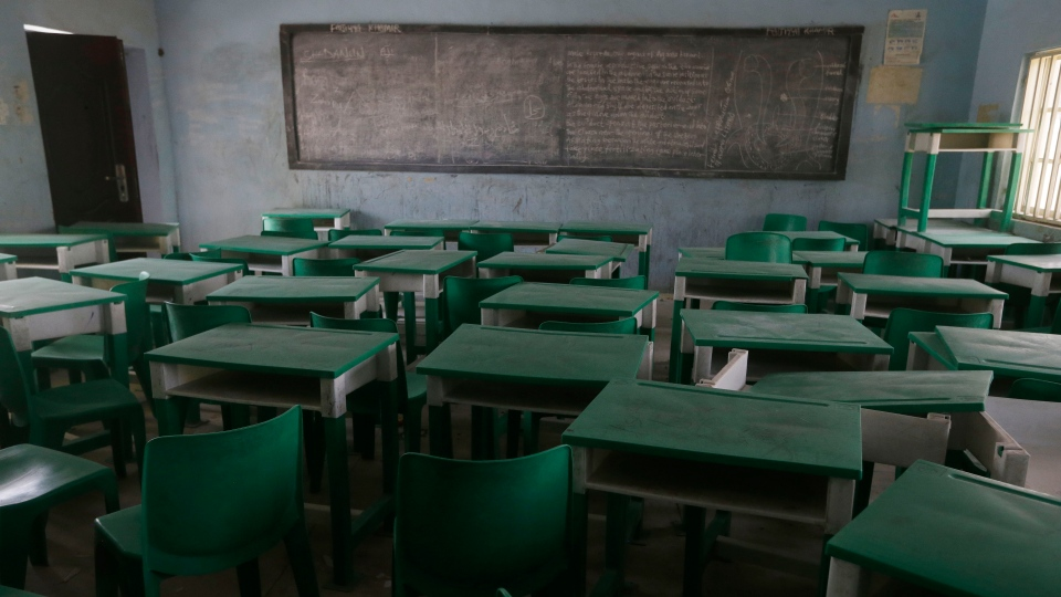 Desks and chairs are seen at the Government Girls Secondary School where more than 300 girls were abducted by gunmen on Friday, in Jangebe town, Zamfara state, northern Nigeria, Monday, March 1, 2021. (AP Photo/Sunday Alamba)