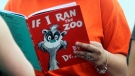 FILE - In this Sept. 24, 2013, file photo, Courtney Keating, education coordinator of The Literacy Center in Evansville, Ind., reads 'If I Ran the Zoo,' By Dr. Seuss. (Erin McCracken / Evansville Courier & Press via AP, File)
