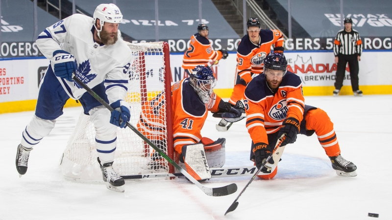 Edmonton Oilers goalie Mike Smith (41) makes the save on Toronto Maple Leafs' Joe Thornton (97) as Adam Larsson (6) defends during third period NHL action in Edmonton on Monday, March 1, 2021. THE CANADIAN PRESS/Jason Franson