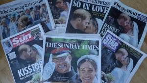 A photo illustration showing a selection of British Newspaper front pages with pictures from the wedding of Prince Harry and Meghan Markle, in London, on May 20, 2018. (Kirsty Wigglesworth / AP)