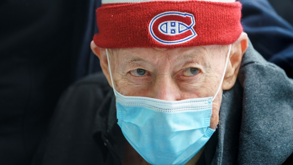 Remo Lisi, 88, waits in line for his COVID-19 vaccine at a clinic at Olympic Stadium marking the beginning of mass vaccination in the Province of Quebec based on age in Montreal, on Monday, March 1, 2021. THE CANADIAN PRESS/Paul Chiasson