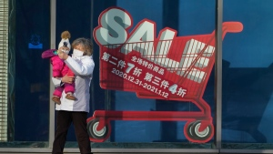 A sale sign outside a mall in Beijing, China, on Jan. 4, 2021. (Ng Han Guan / AP)