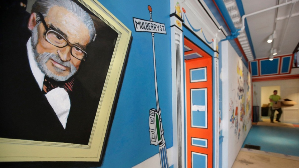 A mural that features Theodor Seuss Geisel, left, also known by his pen name Dr. Seuss, at The Amazing World of Dr. Seuss Museum, in Springfield, Mass., on May 4, 2017. (Steven Senne / AP)