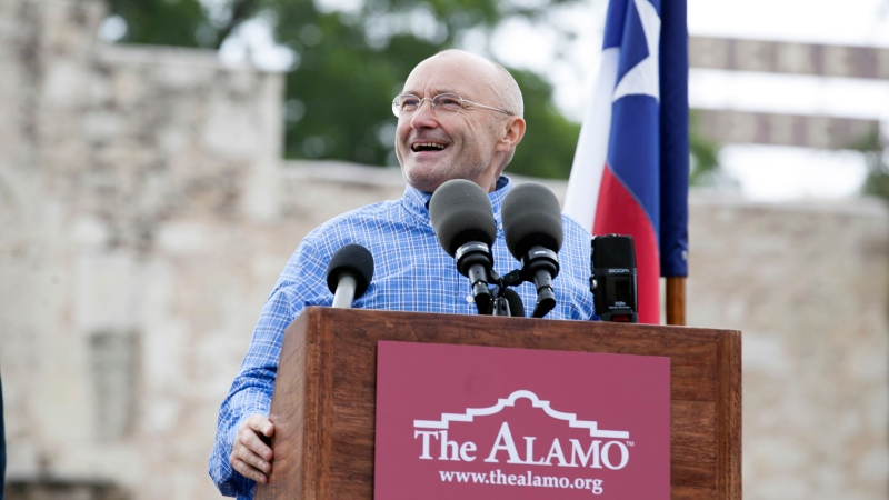 Singer Phil Collins appears in front of the Alamo to announce his donation of over 200 Texas Revolution-era artifacts to the Texas General Land Office on June 26, 2014. A temporary exhibit, which includes a brass cannon used by the Mexican Army during the Battle of the Alamo and the original battle orders that calling for the attack on the Alamo, is on display beginning Tuesday, March 2, 2021 through April 25. (Julysa Sosa/The San Antonio Express-News via AP, File)