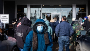 People line up outside a vaccine clinic as seniors wait to get the COVID-19 vaccine in Edmonton Alta, on Friday February 26, 2021. THE CANADIAN PRESS/Jason Franson