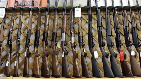 Rifles line a hunting store's shelves in Ottawa, Tuesday, May 16, 2006. (Jonathan Hayward / THE CANADIAN PRESS)