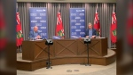 Dr. Brent Roussin (left), Manitoba's chief provincial public health officer, and Premier Brian Pallister, announce changes to public health orders in Manitoba on March 2, 2021. (CTV News Photo Jamie Dowsett)