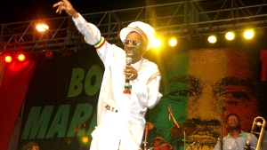 In this Feb. 6, 2005 file photo, Bunny Wailer performs at the One Love concert to celebrate Bob Marley's 60th birthday, in Kingston, Jamaica. Wailer, a reggae luminary who was the last surviving member of the legendary group The Wailers, died on Tuesday, March 2, 2021, in his native Jamaica, according to his manager. He was 73. (AP Photo/Collin Reid, File)