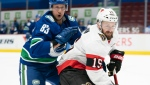 Vancouver Canucks centre Jay Beagle (83) fights for control of the puck with Ottawa Senators centre Derek Stepan (15) during first NHL action in Vancouver, Monday, January 25, 2021. (Jonathan Hayward/THE CANADIAN PRESS)