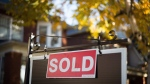 A real estate sold sign hangs in front of a west-end Toronto property in this file photo. THE CANADIAN PRESS/Graeme Roy