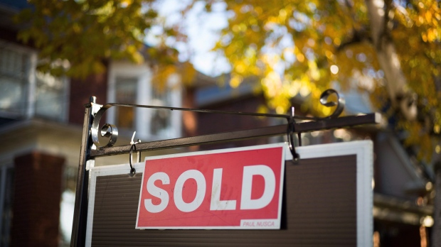 Canadian home sales, prices surge to new record in March