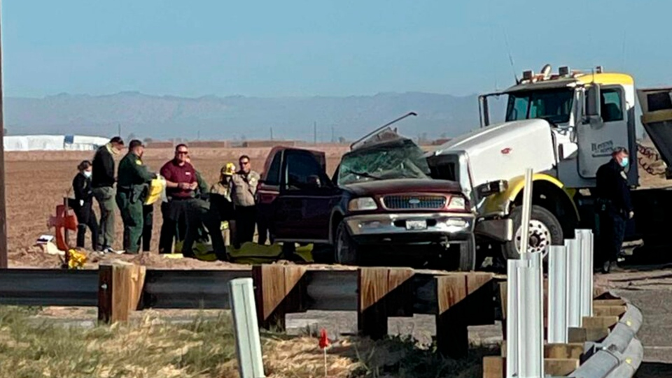 In this image from KYMA law enforcement work at the scene of a deadly crash involving a semitruck and an SUV in Holtville, Calif., on Tuesday, March 2, 2021. (KYMA via AP)