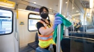 Cleaners demonstrate how they disinfect the train cars of the Sky Train in Vancouver in a May 21, 2020 file photo. Experts say surface transmission of the coronavirus shouldn't be a cause for concern. THE CANADIAN PRESS/Jonathan Hayward