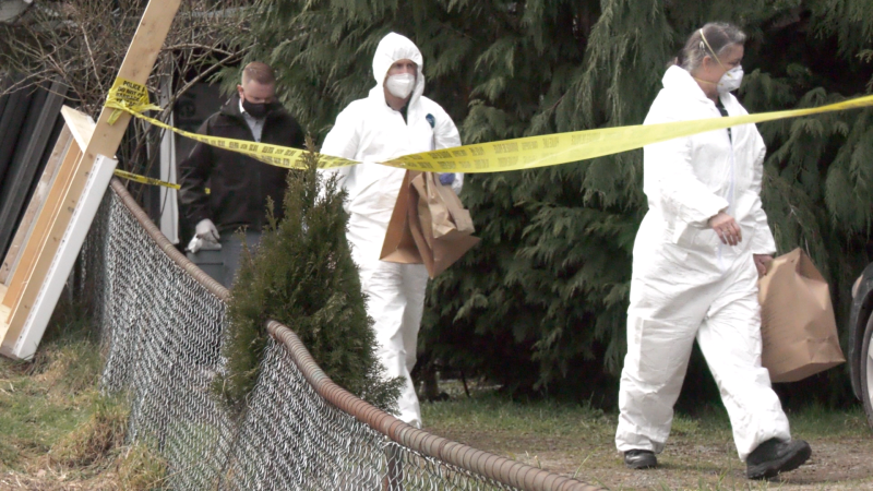 Investigators are seen at the Duncan property on Tuesday, March 2, 2021: (CTV News)