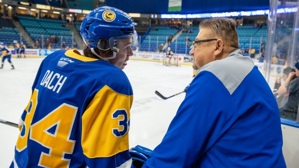 Blades' dressing room attendant Bobby Kirkness on the bench with Colton Dach (Source: Saskatoon Blades)
