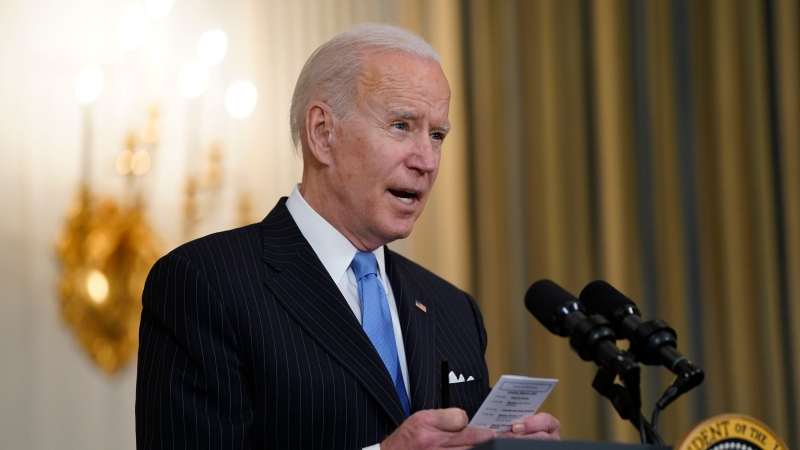 U.S. President Joe Biden speaks about efforts to combat COVID-19, in the State Dining Room of the White House, Tuesday, March 2, 2021, in Washington. (AP Photo/Evan Vucci)