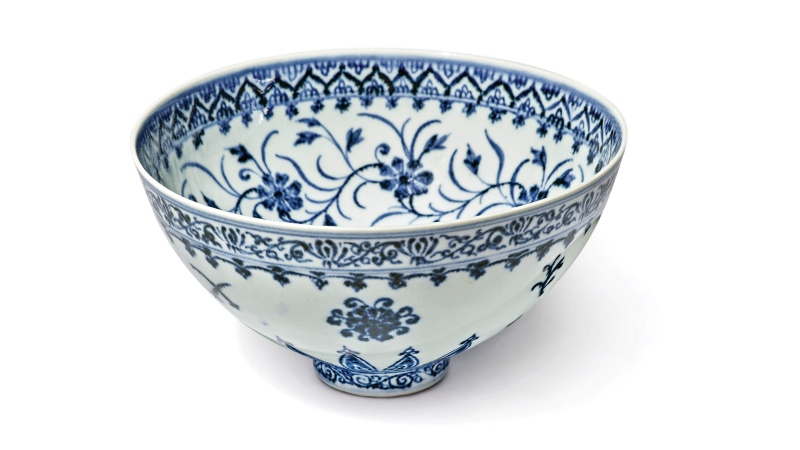 This photo, provided by Sotheby's, in New York, on Tuesday, March 2, 2021, shows a small porcelain bowl bought for US$35 at a Connecticut yard sale that turned out to be a rare, 15th century Chinese artifact worth between $300,000 and $500,000. (Sotheby's via AP)