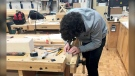 Grade 12 Notre Dame High School student Devon Zuchotzki working on his cabinetry project for the 2021 Skills Alberta competition.