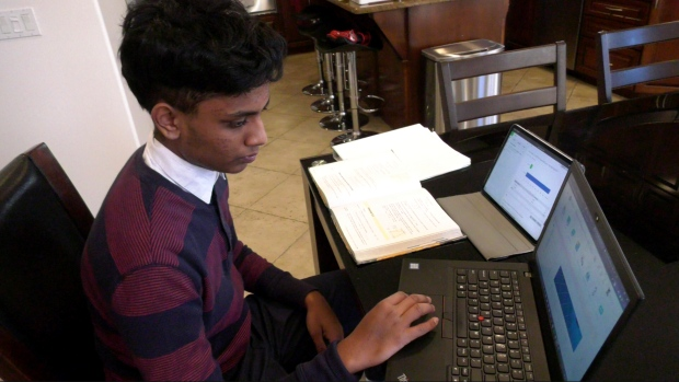 Rishi Naidu, a Grade 11 student at Vincent Massey Secondary, studies at his Windsor home on March 1, 2021. (Rich Garton / CTV Windsor)