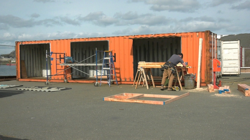 "Thirty ""tiny homes"" fabricated out of shipping containers are being built behind Capital Iron in downtown Victoria. They will be moved to the parking lot of Royal Athletic Park when they are completed: March 2, 2021 (CTV News)"