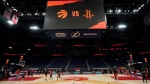Some members of the Toronto Raptors and Houston Rockets take part in a shoot around before an NBA basketball game Friday, Feb. 26, 2021, in Tampa, Fla. (AP Photo/Chris O'Meara)
