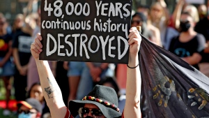 Protesters rally outside the Rio Tinto office after the destruction of Australian Indigenous sacred sites in Perth, June 9, 2020. (Richard Wainwright/AAP Image via AP)