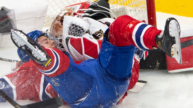Montreal Canadiens centre Jesperi Kotkaniemi (15) crashes into Ottawa Senators goaltender Joey Daccord (34) during second period NHL hockey action Tuesday, March 2, 2021 in Montreal. THE CANADIAN PRESS/Ryan Remiorz