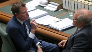 Australia's Prime Minister Scott Morrison, right, talks to Attorney General Christian Porter in the Australian Parliament in Canberra on Thursday, Aug. 1, 2019. (AP Photo/Rod McGuirk)