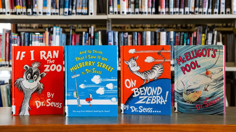 Dr. Seuss childrens' books, from left, 'If I Ran the Zoo,' 'And to Think That I Saw It on Mulberry Street,' 'On Beyond Zebra!' and 'McElligot's Pool' are displayed at the North Pocono Public Library in Moscow, Pa., Tuesday, March 2, 2021. (Christopher Dolan/The Times-Tribune via AP)