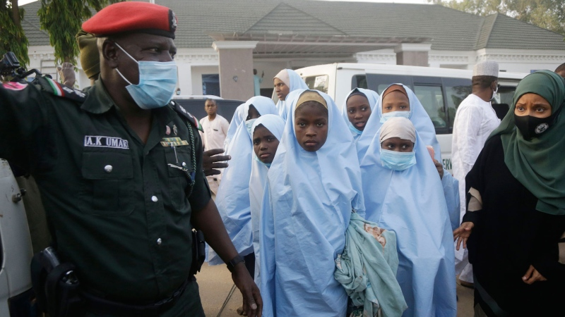 Some of the students who were abducted by gunmen from the Government Girls Secondary School, in Jangebe, last week wait for a medical checkup after their release meeting with the state Governor Bello Matawalle, in Gusau, northern Nigeria, Tuesday, March 2, 2021. (AP / Sunday Alamba)
