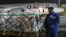 The first arrival of COVID-19 vaccines to Kenya is offloaded from a Qatar Airways flight at Jomo Kenyatta International Airport in Nairobi, Kenya, early Wednesday, March 3, 2021. (AP Photo)