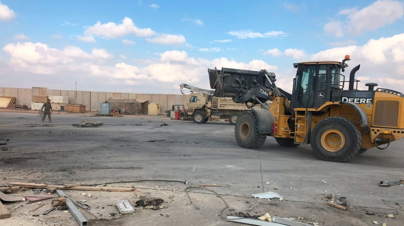 In this file photo, a bulldozer clears rubble and debris at Ain al-Asad air base in Anbar, Iraq, Monday, Jan. 13, 2020. (AP Photo/Qassim Abdul-Zahra)