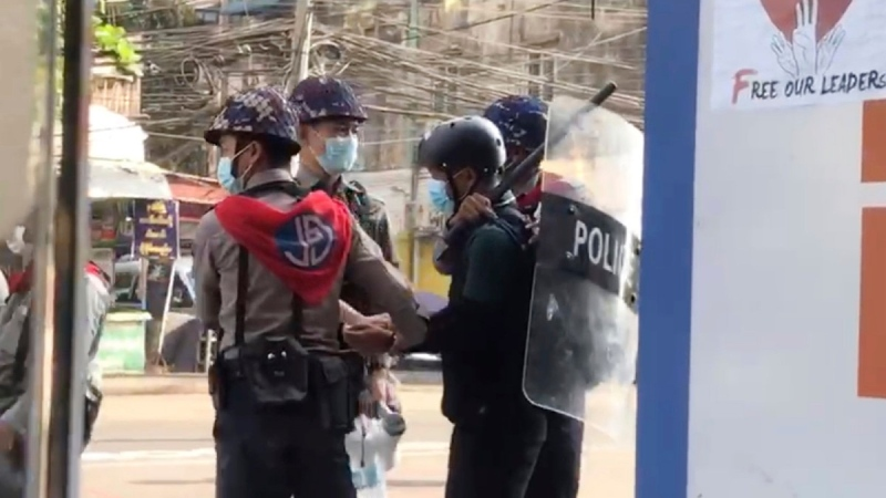 In this image made from video taken on Feb. 27, 2021, Associated Press journalist Thein Zaw is arrested by police in Yangon, Myanmar. (AP)